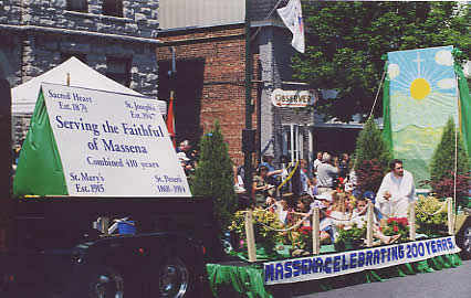 Serving the Faithful of Massena Float